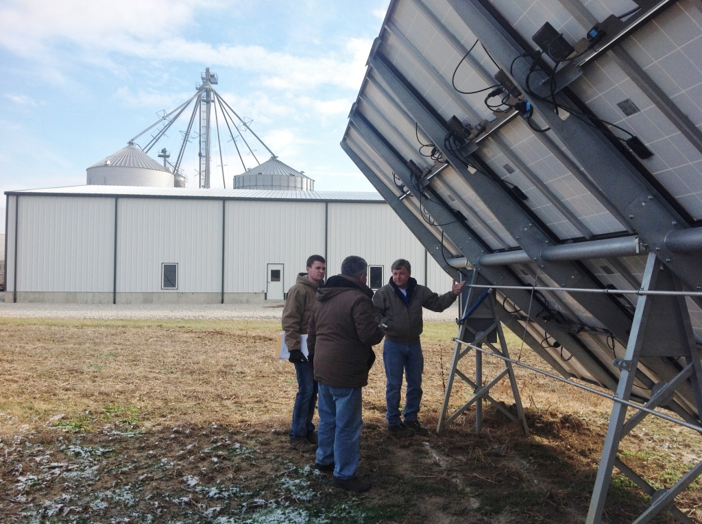 backside of solar PV panels on farm